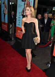 Rose McIver completed her sexy-glam ensemble with a metallic gold clutch by Me Char.