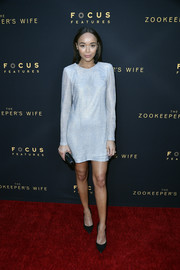 Ashley Madekwe was all about minimalist elegance in a long-sleeve silver cocktail dress by Galvan at the premiere of 'The Zookeeper's Wife.'