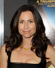 Minnie Driver let her long curls shine on the red carpet by keeping her makeup minimal.
