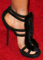 Christina Milian wore an ultra-sexy pair of fur-embellished black strappy sandals to the premiere of 'Baggage Claim.'