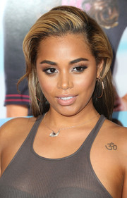 Lauren London looked cool at the 'Baggage Claim' premiere with her teased hairstyle.