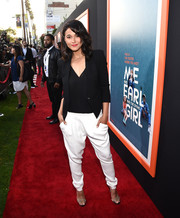 Emmanuelle Chriqui completed her red carpet look with cool white harem pants.