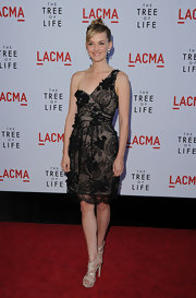 Jess dons a frothy textured one-shoulder cocktail dress for the 'Tree of Life' premiere.