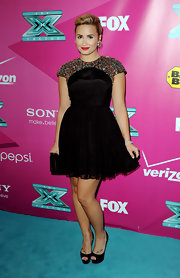 Demi Lovato let her sparkly shoulders steal the spotlight with her simple and sleek black peep-toe pumps.
