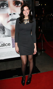 Mandy Moore paired an embellished gray sweater dress with pointy toe ankle boots. On-trend sheer black tights complete her lovely winter look.