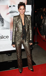 Halle hit the 'Frankie and Alice' premiere in a dramatic gold brocade suit.