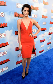 Jaimie Alexander shows some skin in a bright orange cocktail dress.