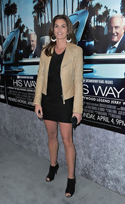 Cindy Crawford showed off her toned lengthy games in a pair of black suede peep toe ankle booties.