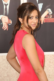 Noureen DeWulf had her hair tied half up leaving a little in front to frame her face.