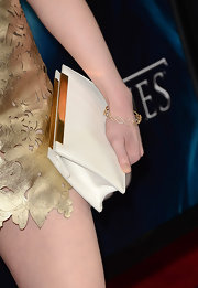 Gwendoline Christie paired a classic white clutch with her gold frock for a touch of sophistication.