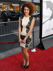 Nathalie Emmanuel chose this nude frock with black lace detailing for a super feminine look on the red carpet.