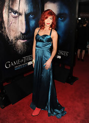 Natalia Tena showed off her figure in this blue satin dress.