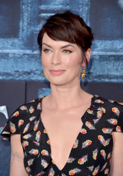 Lena Headey styled her hair into a mildly messy updo for the 'Game of Thrones' season 6 premiere.