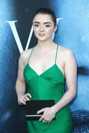Maisie Williams paired a black Giuseppe Zanotti suede clutch with a green slip dress for the premiere of 'Game of Thrones' season 7.