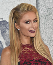 Paris Hilton paired dark purple lipstick with heavy eyeshadow for a striking beauty look during the premiere of 'The Leftovers' season 3.