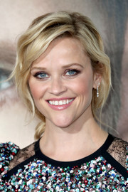 Reese Witherspoon finished off her look with delicate diamond earrings by Tiffany & Co.