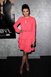 Ginnifer Goodwin donned nude Drama pumps with her lovely tiered salmon dress. The platforms feature elongated almond-shaped toes.