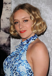 Chloe Sevigny paired her darling curls and bronze eyeshadow with matte brick red lips.