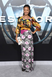 Thandie Newton injected a playful touch with a robot-motif box clutch by Charlotte Olympia.