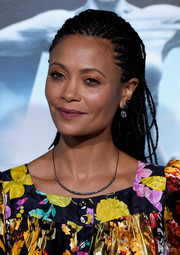 Thandie Newton made her peepers pop with some coral eyeshadow.