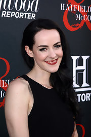Jena Malone arrived at the 'Hatfields & McCoys' premiere wearing her dark tresses in sleek side-swept waves.