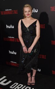 Elisabeth Moss finished off her outfit with classic black ankle-strap sandals.