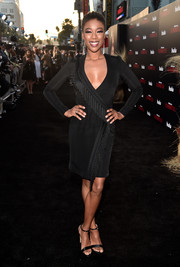 Samira Wiley was sultry and chic in a fringed black wrap dress by Galvan at the premiere of 'The Handmaid's Tale' season 2.