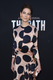 Michelle Monaghan attended the premiere of 'The Path' carrying a blush-colored tube clutch.