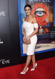Emmanuelle Chriqui paired an all-over beaded gold clutch with a little white dress for the premiere of 'Shut Eye.'
