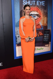 KaDee Strickland dazzled in a bright orange column dress with split sleeves at the premiere of 'Shut Eye.'