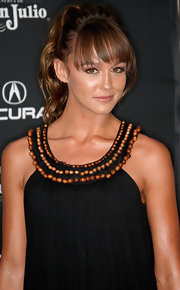 Sharni opted for a playful ponytail with face-framing bangs.