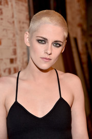 Kristen Stewart paired her shaved head with a smoky eye for total edge!