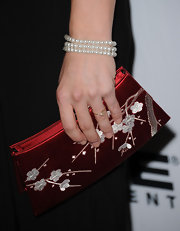 Ashley Williams carried an ornate satin clutch for the premiere of 'Every Day.'