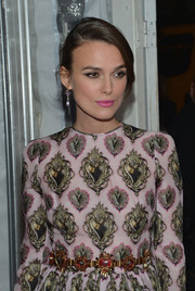 Keira Knightley attended the 'Imitation Game' premiere wearing a lavish gemstone belt by Dolce & Gabbana.