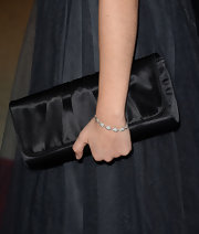 Sarah Hyland carried an oversized satin clutch to the premiere of 'Call Me Crazy.'