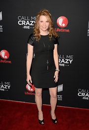 Lea Thompson showed off her curves in this little black dress that featured leather capped sleeves.
