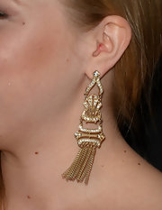 Sofia Vassilieva chose long gold and diamond dangle earrings for her look at the 'Call Me Crazy' premiere.