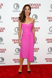 Ana Ortiz wore this hot pink strapless dress that featured a ruched bodice and ruffle detail that crossed the body.