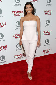 Eva wore a crisp ivory jumpsuit that featured a peplum detail at the waist to the 'Devious Maids' premiere.