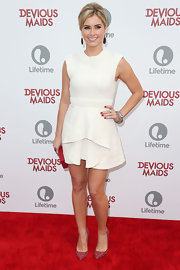 Brianna Brown wore a whit dress with an asymmetrical hem detail in the front.