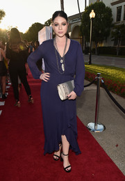 Michelle Trachtenberg went conservative in a long-sleeve purple wrap dress for the premiere of 'Sister Cities.'