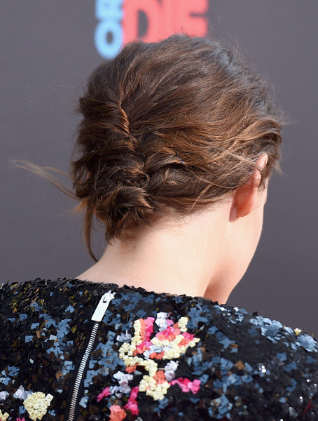 Kristen Stewart sported a messy, edgy version of the classic French twist at the premiere of 'American Ultra.'