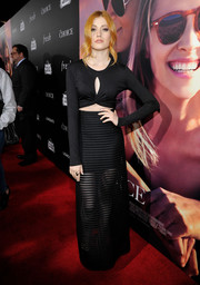 Katherine McNamara amped up the allure with a black mesh maxi skirt.