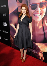 Renee Olstead teamed her dress with classic tan loafer heels.