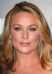 Elisabeth Rohm wore a shimmering silvery eyeshadow to the premiere of 'Abduction'. To try her look, sweep a shiny shadow over upper lids, line upper and lower lash lines with a dark eye pencil and finish with a few coats of mascara.