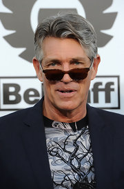 Eric Roberts paired his navy suit with brown cateye sunglasses.