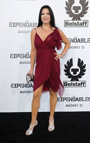 Christina paired her silver sandals with a sheer maroon dress.
