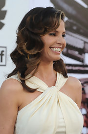 Charisma paired her cream halter dress with radiant curls.