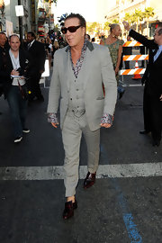 Mickey Rouke paired his printed dress shirt with a grey suit.