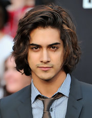 Avan Jogia showed off his healthy brunette mane in a messy wavy haircut.